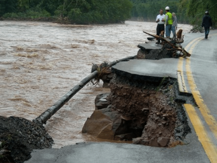 A pipeline is exposed by erosion caused by flooding.